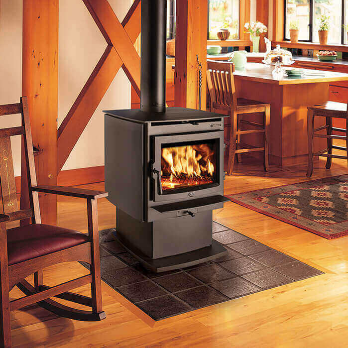 Freestanding wood burning stove with large glass face, available at Luce's Chimney and Stove Shop in Swanton OH.